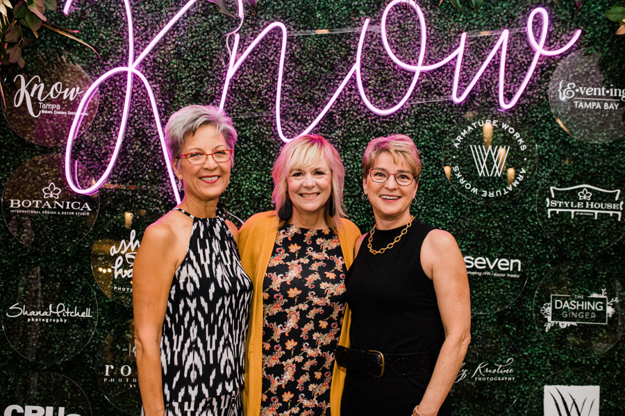 know women posing at event